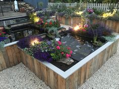 Raised pallet flower bed garden fun pinterest for Pond made from pallets