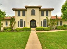 Gorgeous Mediterranean inspired home with tile roof & double door entry on large double corner, cul-de-sac lot 4 Torrington Ct, Austin TX 78738