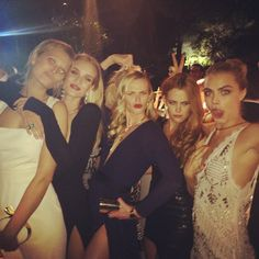 #Toni Garrn, Rosie Huntington-Whiteley, Anne V (center), Danielle Riley, and the ever dramatic Cara Delevingne at Cannes, evening, May 20th, 2014.