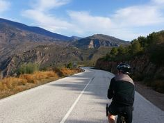 Cycling along perfect desserted roads of the mountainous Alpujarras in Granada, Spain.