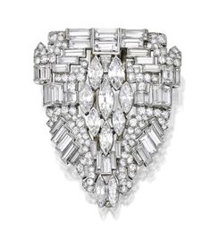 Platinum and Diamond Clip-Brooch. The diamond-set plaque set with baguette, marquise-shaped and old European-cut diamonds weighing approximately 18.10 carats; circa 1930. Sold September 2015 for $12,500 at Sotheby's.