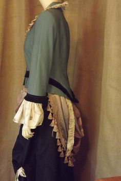 @: Victorian inspired upcycled walking jacket crafted with recycled garments, fabrics and trims.
