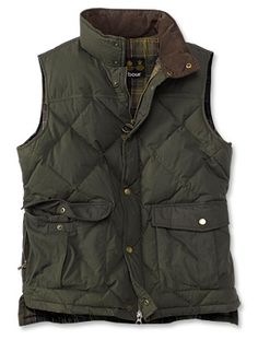 A Barbour quilted barn vest would layer beautifully over a chunky creme sweater.