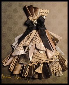 Paper dress Number 4--- made with paper and vintage crochet and ribbon by Brenda Henning