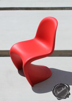 Modern outdoor patio design by Stardust in Sonoma California featuring the Panton Chair. The Panton Chair with its distinctive styling and sweeping lines is a customer favorite! The Panton Chair (also known as Panton S Chair) was designed by Danish/Swiss designer Verner Panton in 1967 and is produced by Vitra in Europe. This is the New Panton Chair with a matte finish; perfect for both indoor- and outdoor applications. http://www.stardust.com/PANTONCHAIR.html