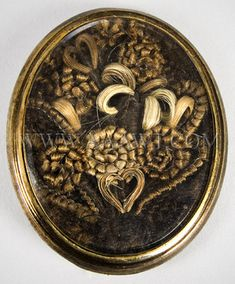 """Absolutely beautiful thick weave hairwork brooch. """"Antique Brooch, Hairwork, Flower and Heart Design"""" for sale on http://www.aaawt.com/html/text_gallery6.html"""