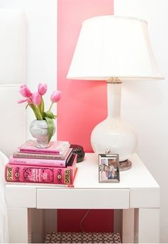 pink and white vignette with wide pink wall stripe