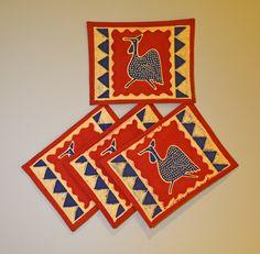 Setof4 hand printed Africanplacemats. TheseplacematsarehandprintedbyZimbabweanwomenwhoworkfromhome. TheirwaresarethensoldattheAvondaleMarketinHarare, Zimbabwe. This set was mad