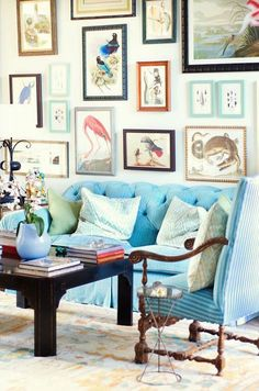 I Need Your Help! Eclectic Gallery Walls - laurel home | fabulous art wall from Thous Swell | love the colors and the mismatched frames | and it compliments the furnishings perfectly.