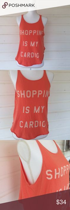 """Shopping is My Cardio Wildfox Tank Iconic start to an amazing brand and trend. """"Shopping is my cardio"""" crop tank from Wildfox. Some signs of use, no damage. Oversized size small. Bright and beautiful coral color. Offers always warmly received. Wildfox Tops"""