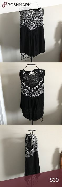 "Lucky Brand Black Embroidered Tank Only worn once. Good condition. Black with adorable embroidery. Measurements lying flat: armpit to armpit 19.5"". Length of sides 25"" and length of front and back 29"". Size large.  ❌ No trades or off Poshmark transactions.   👌🏻Quick shipping.   💁🏻Offers welcome through ""Make an Offer"" feature.   👗👠 Bundle discount.   ❔ Feel free to ask any questions. Lucky Brand Tops Tank Tops"