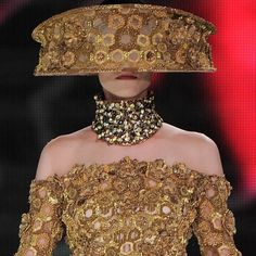 The Alexander McQueen SS13 gold 3D embroidered honeycomb headpiece and topaz Bee neck piece
