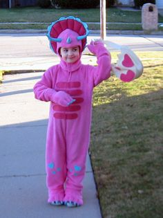 My niece's 2012 Halloween costume. She was going to be a rainbow princess but then she changed her mind when she saw this pattern. Used Simplicity 1765 for the suit and made up the dinosaur egg bag on my own.