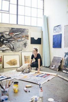 A downward dog and artist/designer Elle Luna in her studio