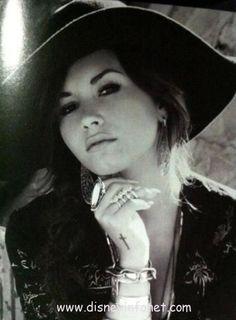 Demi Lovato-- her cross tat is my favorite
