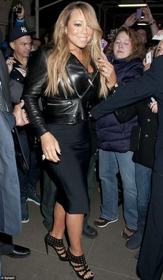 Imperial in leather: Mariah Carey crammed her curves into a tight biker jacket in New York on Friday
