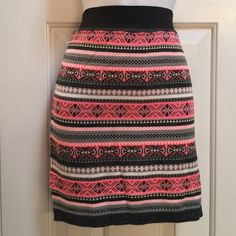 Tribal Print Sweater Skirt Beautiful tribal print skirt in colors of neon pink, white, black and gray Black elastic waistband Made of 90% acrylic & 10% nylon New, without tags Never washed Never worn Mudd Skirts