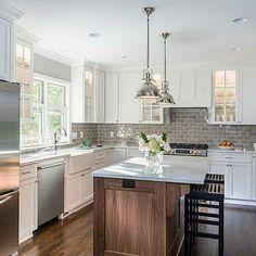White kitchen with gray backsplash