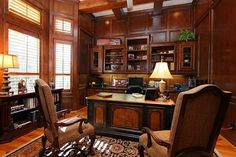 Beautiful Office with wood paneling and plantation style shudders.