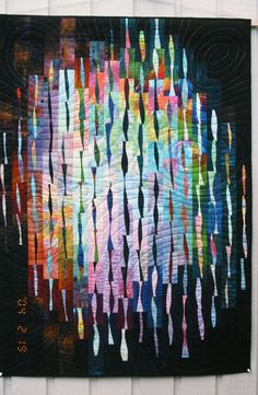 By Bonnie Hwang ~ lovely sense of illumination with arrangement of curved piecing. Neatly done.