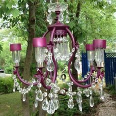 Upcycled chandelier with solar lights for garden