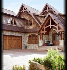 a little bit too lodge-y, but i love the porch and the combo of cedar and stone #LittleCabin