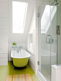Vintage Cottage  Playing the Angles  A long narrow skylight above the tub welcomes views of the sky and helps the angular space feel more open. The outside of the clawfoot tub was painted the same chartreuse hue as the floor, which creates a clean, uniterrupted look.