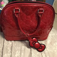 Hello kitty handbag! Great condition a few scratches on the bottom and one on the side. See pictures! No trades. Feel free to make a reasonable offer. Hello Kitty Bags