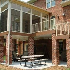 With the addition of underdecking and a concrete patio, usable space was created underneath this elevated deck and outdoor room. Outdoor Living Areas, Outdoor Rooms, Back Patio, Backyard Patio, Eze Breeze Windows, 4 Season Room, Room Additions, Screened In Porch, Concrete Patio