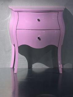 Diva collection luxury bedside table with tiny chrome finish pull knob. Shown here in lilac high gloss. Influenced by the Louis French design but the without carvings and a modern finish.