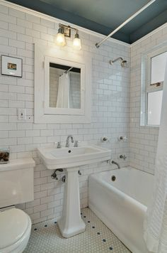 Bathroom Remodel Subway tile & hex tile abound in this vintage bathroom of a restored Seattle Cra. Subway tile & hex tile abound in this vintage bathroom of a restored Seattle Craftsman bungalow. Bungalow Bathroom, Craftsman Bathroom, Bathroom Renos, Bathroom Renovations, Bathroom Interior, Bathroom Flooring, Small Bathroom, Bathroom Ideas, Bathroom Organization