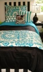 Turquoise and black college dorm room