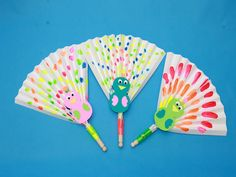 Here's a fun kid craft for this summer that will keep you and your kids cool: peacock paper fans!