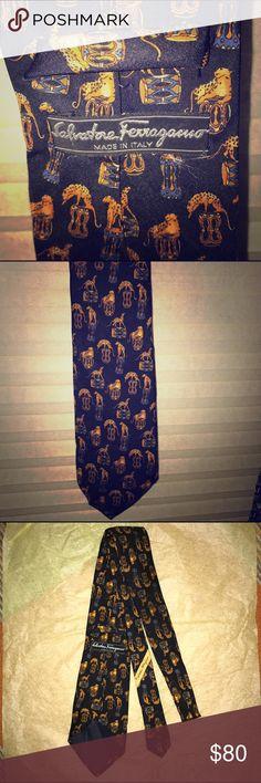 Salvatore Ferragamo silk tie 👔 cheetah design This Salvatore Ferragamo silk tie 👔 is in vintage good condition, no visible marks or stains. Elegant cheetah design. Salvatore Ferragamo Accessories Ties