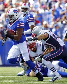 Buffalo Bills running back Fred Jackson gets past New England Patriots   Steve Gregory during the first half of an NFL football game on Sunday 58f09cd60