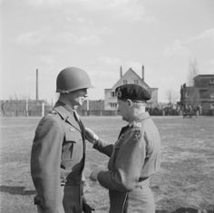 Personalities: Major-General James Gavin, Commander of the 82nd (US) Airborne Division receiving the DSO from Field Marshal Sir Bernard Montgomery in Munchen Gladbach