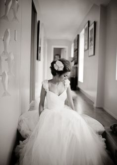 Waiting for her man photography wedding black and white hair flower dress elegant bride