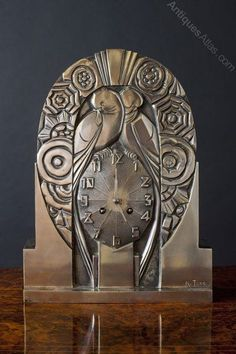 Antiques Atlas - Art Deco Silvered Bronze Clock signed R.Terras. Beautifully designed case with geometric stylised birds and decoration, stepped base with original stepped silvered 'Deco'hands. Eight day French movement striking the hours and halves on a silvered bell, signed 'Japy Freres'. C.1925