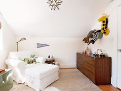 When I was pregnant with my daughter, we transitioned our almost two-year-old to a big boy bed. Since we were changing his bed, I also decided to change his room up a little bit to give him more spaces to play, read, and incorporate some of his interests in the decor. When designing his nursery, I used a neutral color scheme of beige and white with accents of green and invested in pieces of furniture that would be multipurpose to use in his room as he grew. Then, when I changed up his room…