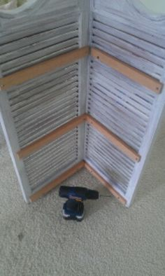 Thrifty Treasures: Make shutters into a corner shelf
