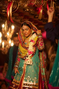 Love her look-minimal makeup + the patterns and colors! Via South Asian Bride Magazine