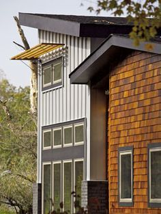 love the weathered grey wood board and batten siding on