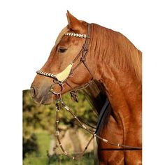 The Barefoot Seneca 3-in-1 'Knotted Rope Bridle' Halter Bridle Combo has four (4) stainless steel rings and adjustable knots to fine tune the fitting to your horse's head. Use with the matching Barefoot Seneca mecate reins.