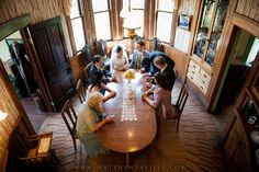June 2013 Wedding at the Heritage Museum of Orange County - Signing the Marraige License in the Oval Dining Room of the historic Kellogg House - Photo by Matthew Saville