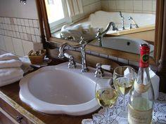 A sink inserted into a vintage dresser