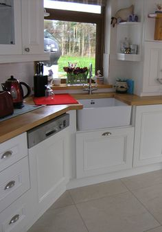 We are a family-owned business based in Waterford, Ireland, for over 40 years, delivering tailor-made kitchens to your specifications. Kitchens, Kitchen Cabinets, Architecture, Home Decor, Home, Arquitetura, Decoration Home, Room Decor, Cabinets
