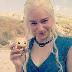 Game of Thrones actors posing with their Funko toy counterparts