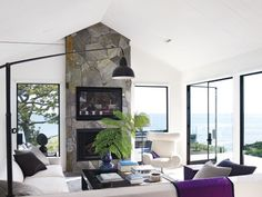beautiful fire place with lots of windows