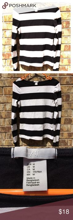 H&M black and white striped long sleeve shirt H&M black and white striped long sleeve shirt has gold buttons on the sleeves and on the left shoulder. The buttons are just for show. H&M Tops Tees - Long Sleeve