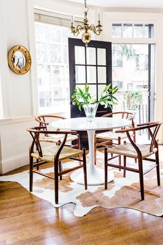 """Christine's biggest challenge: """"Designing around 'renter white' walls and old blinds. Resisting my urge to change them, knowing that we would only be in the space for two years."""""""